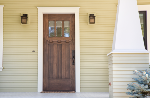Wooden front door with a new lock in Addison, Illinois