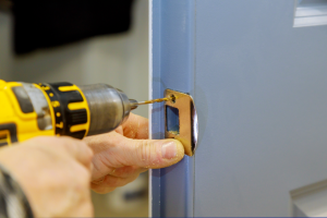 Locksmith installing a new lock on a front door in Wood Dale, Illinois